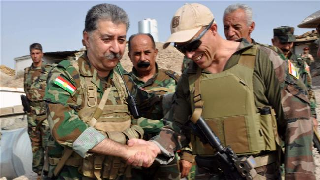In this picture, posted on Facebook on August 31, 2016, Hussein Yazdanpanah, the leader of the terrorist Kurdistan Freedom Party (PAK), shakes hands with an unidentified individual purported to be a Western military advisor. (Via AP)